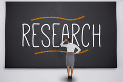 Businesswoman reading research Stock Image