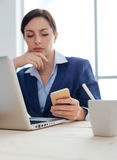 Businesswoman reading sms Royalty Free Stock Image