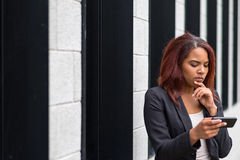 Businesswoman Reading Something on Mobile Phone Royalty Free Stock Image