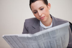 Businesswoman reading stock report Stock Images