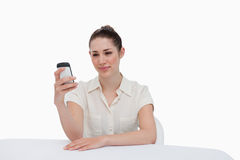Businesswoman reading a text message Stock Photos