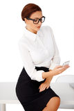 Businesswoman reading a text message Royalty Free Stock Photo