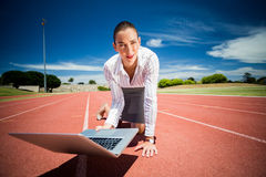 Businesswoman ready to run with a laptop Royalty Free Stock Images