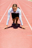 Businesswoman ready to run on running track Royalty Free Stock Images
