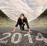 Businesswoman ready to start year 2014. Businesswoman on a road ready to run Royalty Free Stock Photos