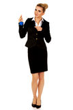 Businesswoman real estate agent with house pendant Royalty Free Stock Photos