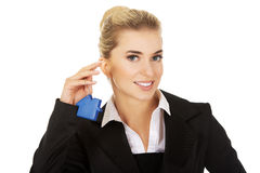 Businesswoman real estate agent with house pendant Royalty Free Stock Images