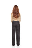 Businesswoman - rear view hands clasped. Isolated full length studio shot of the rear view of a Caucasian businesswoman standing with hands clasped Stock Images