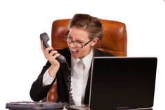 Businesswoman received bad news over the phone. Office rage series - businesswoman received bad news over the phone and is screaming in rage Stock Images
