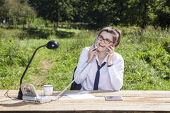 Businesswoman receives two phones at once Royalty Free Stock Photography