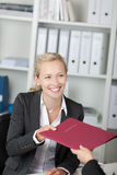 Businesswoman Receiving Application Map Stock Photography