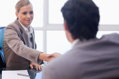 Businesswoman receiving a customer Stock Photos
