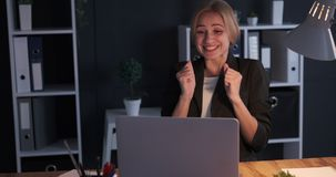 Businesswoman receiving positive news on laptop. Surprise businesswoman receiving good news on laptop during night shift at office stock video