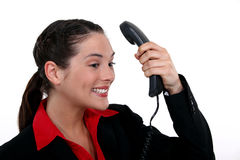 Businesswoman receiving positive phone call Royalty Free Stock Image