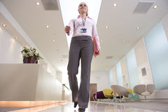 Businesswoman by reception, low angle view Royalty Free Stock Images