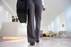 Businesswoman by reception, low section Stock Images
