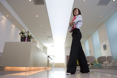 Businesswoman by reception, portrait, low angle view Stock Photography