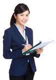 Businesswoman record something on folder Stock Images