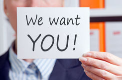 Businesswoman recruiting. Hand of businesswoman with we want you recruiting sign Stock Photos