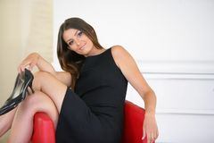 Businesswoman in red armchair Royalty Free Stock Image
