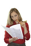 Businesswoman in red blouse pondering over document, cut out Stock Photo