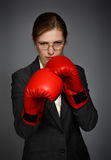 Businesswoman in red boxing gloves Stock Photography