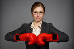Businesswoman in red boxing gloves Stock Photo