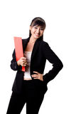 Businesswoman with a red file. Smiling female executive holding a red file Royalty Free Stock Photography
