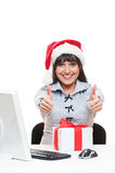 Businesswoman in red hat showing thumbs up Stock Photos