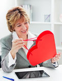 Businesswoman with red heart present Royalty Free Stock Images