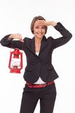 Businesswoman  with red kerosene lamp Stock Photos
