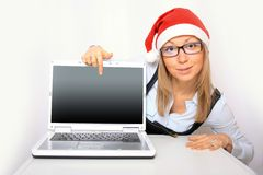 Businesswoman with a red Santa hat Royalty Free Stock Photo