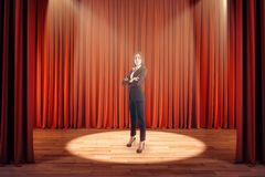Businesswoman on red stage royalty free stock images
