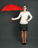 Businesswoman with red umbrella Stock Photos