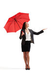 Businesswoman with red umbrella Stock Photography