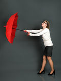 Businesswoman with red umbrella Royalty Free Stock Photos