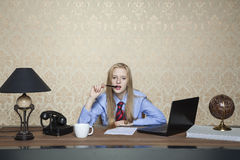 Businesswoman reflects on a new contract Royalty Free Stock Image