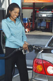 Businesswoman Refueling Car Stock Photography