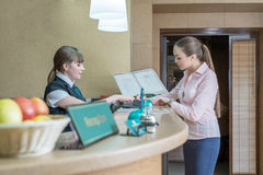 Businesswoman registers on arrival in hotel Stock Image