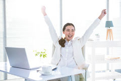Businesswoman rejoicing with arms outstretched Stock Photography