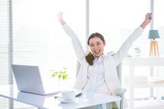 Businesswoman rejoicing with arms outstretched Royalty Free Stock Photos