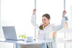 Businesswoman rejoicing with arms outstretched Stock Image