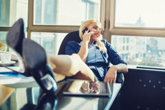 Businesswoman relaxed at work Royalty Free Stock Image