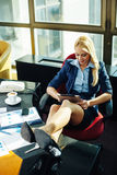 Businesswoman relaxed at work Royalty Free Stock Photos