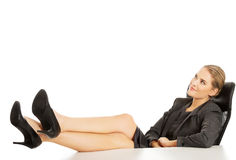 Businesswoman relaxing on armchair Royalty Free Stock Photography