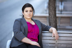 Businesswoman - Relaxing on a bench Stock Image