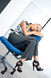 Businesswoman relaxing in the chair Stock Photo