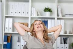 Businesswoman Relaxing At Desk Royalty Free Stock Photography