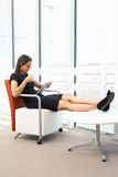 Businesswoman Relaxing With Digital Tablet Royalty Free Stock Image