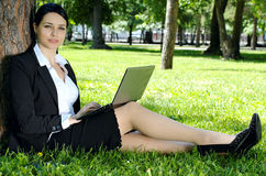 Businesswoman relaxing with laptop Stock Photography